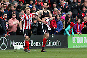 Lincoln City forward Ollie Palmer (8) scores a goal 3-2 and celebrates  during the EFL Sky Bet League 2 match between Lincoln City and Exeter City at Sincil Bank, Lincoln, United Kingdom on 30 March 2018. Picture by Mick Atkins.