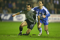 WIGAN, ENGLAND - TUESDAY, JANUARY 31st, 2006: Everton's Leon Osman (C) celebrates scoring the opening goal as Wigan Athletic David Thompson looks dejected during the Premiership match at the JJB Stadium. (Pic by David Rawcliffe/Propaganda)