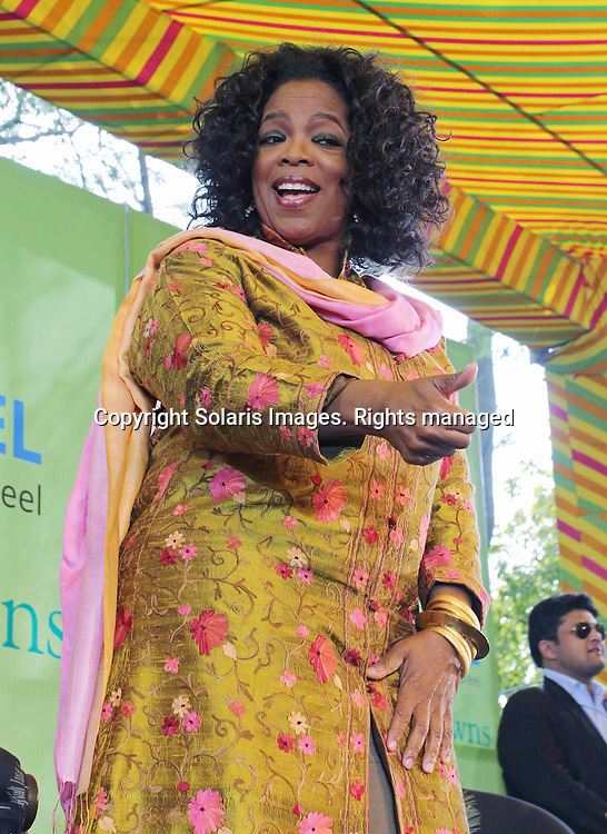 Oprah Winfrey, American talk show host arrive for the conversation with Barkha Dutt (not in the picture) wearing the tradition Indian dress greets the crowd on the third day of the Jaipur Literature festival in Jaipur, India on January 22, 2012. The festival is one of the Asia's finest and over 200 of the world's best authors will be here from January 20 to 24. (Ramesh Nair/SOLARISIMAGES)
