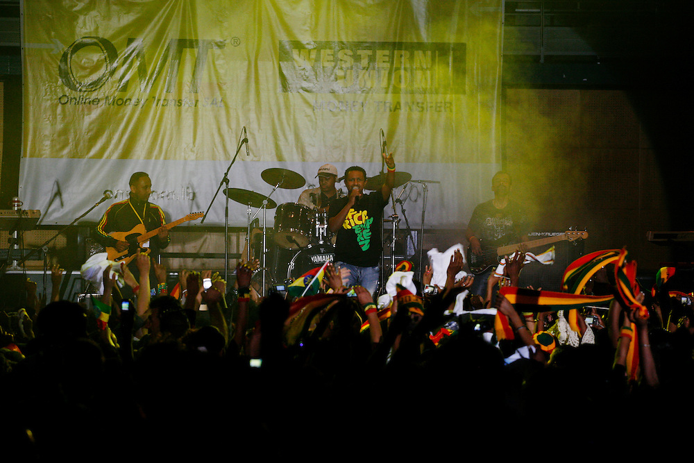 Teddy Afro performing on stage.