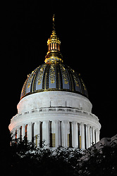 The West Virginia State Capitol illuminated at night.