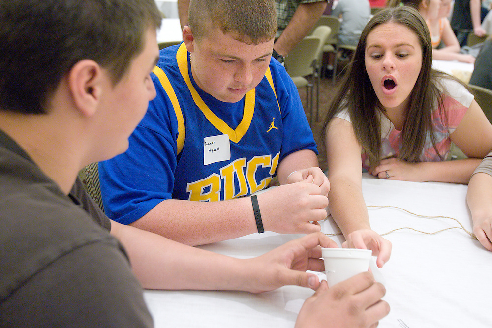 Cody Hill (from left), Tanner Hysell and Contessa Fish work together to design a safe and accurate method to drop an egg during the Russ College of Engineering and Technology research fair/engineering day in the Baker Center ballroom on Thursday, 5/3/07.