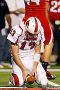 Louisville quarterback Justin Burke (13) reacts after getting sacked on 4th down in the Cardinals final possession against Utah during the fourth quarter of an NCAA college football game at Rice-Eccles Stadium, Saturday Sept. 26, 2009, in Salt Lake City. Utah defeated Louisville 30-14.  (AP Photo/Colin Braley)