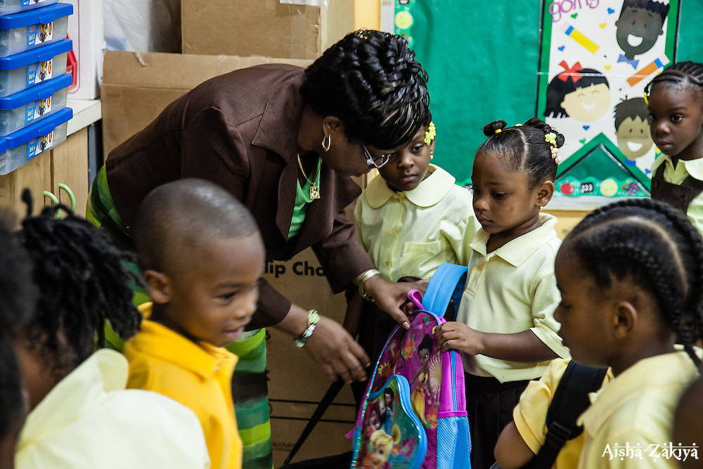 Mrs. Sharon Robles instructs her kindergarten class on the first day of school at Joseph A. Gomez Elementary School. 4 September 2012.  © Aisha-Zakiya Boyd