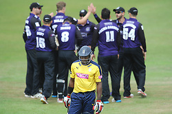 Michael Carberry of Hampshire is bowled out by Craig Miles of Gloucestershire for 12  - Photo mandatory by-line: Dougie Allward/JMP - Mobile: 07966 386802 - 14/07/2015 - SPORT - Cricket - Cheltenham - Cheltenham College - Natwest T20 Blast