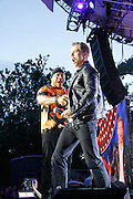 LL Cool J and Derek Hough appear during the Lip Sync Battle Live at SummerStage in Rumsey Playfield Central Park in New York City, New York on July 13, 2015.