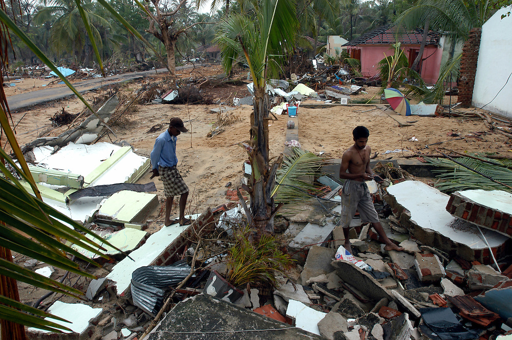 Victims of the December 26, 2004 Tsunami begin to return to their devastated homes from displaced person's camps to start the process of clearing away the debris and picking up the pieces of their lives..Batticaloa, Sri Lanka. 11/01/2005       .Photo © J.B. Russell