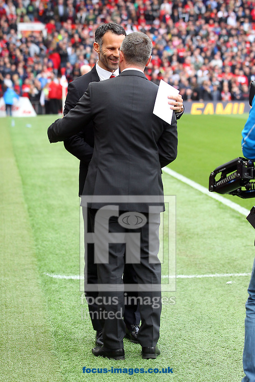 Man Utd Interim Manager Ryan Giggs and Norwich Manager Neil Adams before the Barclays Premier League match at Old Trafford, Manchester<br /> Picture by Paul Chesterton/Focus Images Ltd +44 7904 640267<br /> 26/04/2014