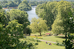 © Licensed to London News Pictures. 22/07/2014. Richmond, UK. A view of the River Thames from Richmond Hill.  People enjoy the sunny hot weather on the banks of the River Thames at Richmond, Surrey, today 22th July 2014. Photo credit : Stephen Simpson/LNP