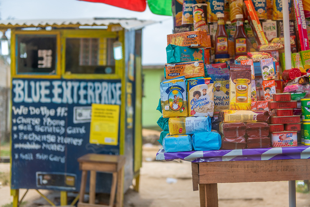 A booth selling various snacks and food items. Monrovia, Liberia
