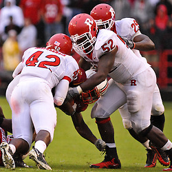 Sep 26, 2009; College Park, MD, USA; Rutgers players Steve Beauharnais (42), Eric Legrand (52) and Zaire Kitchen (29) tackle Maryland running back Davin Meggett (8) during the second half of Rutgers' 34-13 victory over Maryland in NCAA college football at Byrd Stadium.