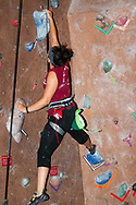 A student navigates the rock climbing wall in The Sett Rec at Union South in 2014.