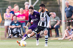 (L-R) Federico Chiesa of ACF Fiorentina, Mohammed Osman of Heracles Almelo during the Pre-season Friendly match between Heracles Almelo and Fiorentina at Sportpark Wiesel  on August 01, 2018 in Wenum-Wiesel , The Netherlands