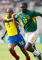 Fotball<br /> LYON FRANCE 26/06/03 FIFA CONFEDERATIONS CUP<br /> THE LAST ACTION PICTURE OF MARC VIVIEN FOE CAMEROON IS CHALLENGED BY JORGE LOPEZ COLOMBIA. SADLY MARC LATER COLLAPSED DURING THE CAMEROON V COLUMBIA MATCH. HE DIED LATER.<br /><br /> Photo Masahide Tomokoshi/Digitalsport