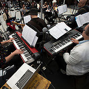 "June 21, 2014 - New York, NY : <br /> The city was flooded with music on Saturday as Make Music New York brought more than 1,300 free concerts to the city's streets and parks. The annual festival's program included the performance ""'In (Key)' - New Compositions in Celebration of Terry Riley's 'In C' @ 50 Years"" on Cornelia Street, in front of the Cornelia Street Cafe in Greenwich Village, on Saturday afternoon. Pictured here, the musicians, including Patrick Grant, foreground left, and Jed Distler, foreground right, perform a piece on Saturday afternoon. Grant was also one of the organizers of the event. Grant and Distler were instrumental in organizing the event. <br /> CREDIT: Karsten Moran for The New York Times"