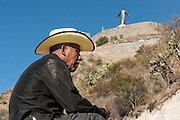 A Mexican cowboy rests in site of the Cristo Rey shrine on top Cubilete Mountain at the end of the annual Cabalgata de Cristo Rey pilgrimage January 6, 2017 in Guanajuato, Mexico. Thousands of Mexican cowboys take part in the three-day ride to the mountaintop shrine of Cristo Rey which concludes on the Day of Epiphany.