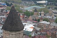 old and new architecture in Tbilisi, Georgia,view on old city center with churchs,old houses and modern bridge and constructions. Javaris Mama Church,Sioni Cathedral,Bridge of Peace and Rike Park