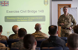 Lieutenant Colonel Hedley French, Officer Commanding Exercise Civil Bridge giving his opening briefing.    09/03/2015.       <br /> <br /> Exercise Civil Bridge is an Overseas Training Exercise (OTX) conducted twice a year in support of UK Defence Engagement by elements of 77 Brigade. Civil Bridge 14B(CB 14B) is being conducted in Sarajevo, Bosnia and Herzegovina (BiH).  By assisting the BiH Government to develop their contingency plans for natural disasters at both strategic and operational levels, CB14B will contribute to the long term international effort to stabilise BiH ethinic groups and authorities.<br /> <br /> Credit should read: Cpl Mark Larner RY/MOD<br /> <br /> (c)MOD 2015