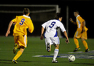 9 NOV. 2010 -- ST. LOUIS -- Christian Brothers College High School soccer player Jake Bond  (9, left) and St. Louis University High School's Richie Hoffman (9, right) chase the ball upfield during the MSHSAA Class 3 Sectional game at SLUH Tuesday, Nov. 9, 2010. The Jr. Bills won, 2-1, on a pair of first half goals by Ryan Merrifield. SLUH will take on Jackson High School Saturday, Nov. 13 at Jackson.  Image © copyright 2010 Sid Hastings.