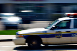 Police car rushing over Germantown Avenue in Chestnut Hill.(Bas Slabbers/for NewsWorks)