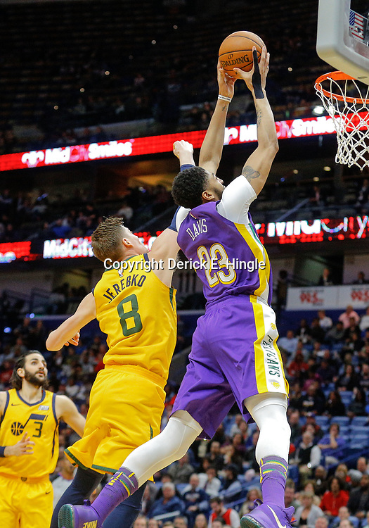 Feb 5, 2018; New Orleans, LA, USA; New Orleans Pelicans forward Anthony Davis (23) is fouled by Utah Jazz forward Jonas Jerebko (8) as he goes to the basket during the second quarter at the Smoothie King Center. Mandatory Credit: Derick E. Hingle-USA TODAY Sports