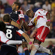 Andrew Farrell, New England Revolution, heads clear from Jamison Olave, New York Red Bulls, (right), during the New York Red Bulls V New England Revolution, Major League Soccer regular season match at Red Bull Arena, Harrison, New Jersey. USA. 5th October 2013. Photo Tim Clayton