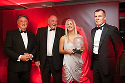 Wales' Kylie Davies picks up the Women's Player of the Year Award on behalf of Jessica Fishlock from Vauxhall's Dennis Chick (L), FAW President Trefor Lloyd-Hughes (C) and Wales women's manager Jarmo Matikainen at the FAW Footballer of the Year Awards 2014. (Pic by David Rawcliffe/Propaganda)