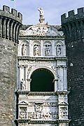 The single-sided white marble triumphal arch spanning the two western towers of the Castel Nuovo often called the Maschio Angioino is a medieval castle located in front of the Piazza Municipio in Naples, southern Italy. First erected in 1279, one of the main architectural landmarks of the city. It was a royal seat for kings of Naples, Aragon and Spain until 1815.