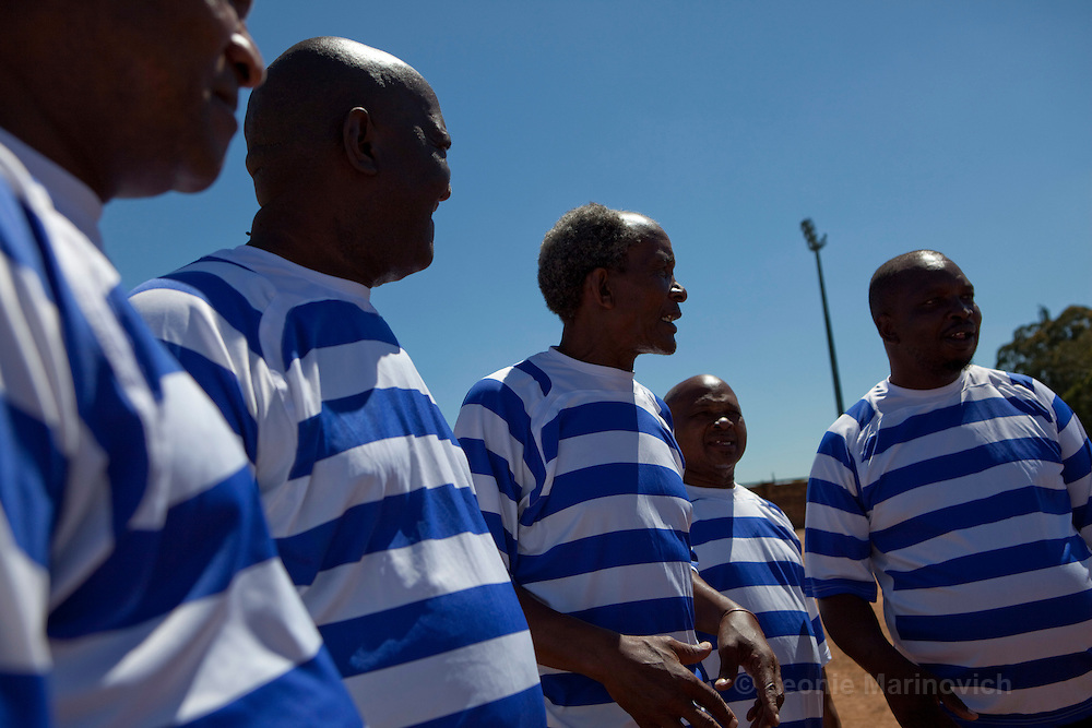 """21 February 2010, Sharpeville, South Africa. Simon """"Bull"""" Lehoko (3rd from right), voted one of the top 50 football players of all time, with his team """"Soccer Legends"""" and Bricks Mokolo (far right)"""