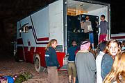 Ravers unloading sound equipment from a lorry at Middle East Tek, Wadi Rum, Jordan, 2008