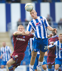 COLCHESTER, ENGLAND - Saturday, September 25, 2010: Tranmere Rovers' Ian Thomas-Moore is beaten to the ball in the air by   Colchester United's Marc Tierney during the League One match at the Colchester Community Stadium. (Photo by Gareth Davies/Propaganda)