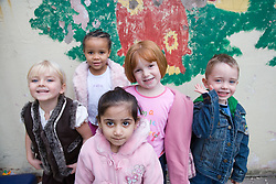 Group of playschool children at breaktime,