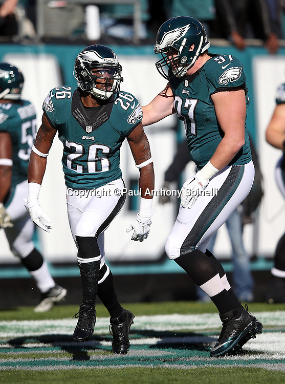 Philadelphia Eagles defensive end Taylor Hart (97) celebrates with Philadelphia Eagles strong safety Walter Thurmond (26) after Thurmond causes a safety that gives the Eagles a 9-3 first quarter lead during the 2015 week 10 regular season NFL football game against the Miami Dolphins on Sunday, Nov. 15, 2015 in Philadelphia. The Dolphins won the game 20-19. (©Paul Anthony Spinelli)