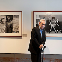 Magnum photographer Elliott Erwitt poses for a picture in front one of his iconic pictures during the press preview of his exhibition 'Personal Best' on March 29, 2012 in Venice, Italy. The exhibition 'Personal Best' on the island of Giudecca will stay open until 15th July 2012