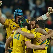 Quade Cooper, Australia, (facing) celebrates with team mates Berrick Barnes, (left) and Anthony Faingaa (right) as James Horwill move in during the South Africa V Australia Quarter Final match at the IRB Rugby World Cup tournament. Wellington Regional Stadium, Wellington, New Zealand, 9th October 2011. Photo Tim Clayton...