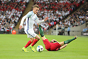 England forward, Jamie Vardy (11) beating Portugal midfielder, Vieirinha (11) to the ball during the Friendly International match between England and Portugal at Wembley Stadium, London, England on 2 June 2016. Photo by Matthew Redman.