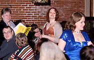"(standing, from left) An audience member participates with Tamra Francis and Heather Gorby during Mayhem & Mystery's production of ""Tragedy in the Theater"" at the Spaghetti Warehouse in downtown Dayton, Monday, February 28, 2011."