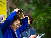 """10 OCTOBER 2018 - SEOUL, SOUTH KOREA: LEE YONG-SOO, one of the few surviving """"comfort women"""" weeps and makes a heart symbol with her hands while ending a speech about her experiences as a sexual slave for the Japanese Army during World War II. She was speaking at the Wednesday Demonstration to protest Japan's sexual enslavement of Korean women during World War II. Lee has said she was tortured with electic shock and raped by Japanese soldiers four to five times a day during her enslavement. The Wednesday protests have been taking place since January 1992. Protesters want the Japanese government to apologize for the forced sexual enslavement of up to 400,000 Asian women during World War II. The women, euphemistically called """"Comfort Women"""" were drawn from territories Japan conquered during the war and many came from Korea, which was a Japanese colony in the years before and during the war. The """"comfort women"""" issue is still a source of anger of many people in northeast Asian areas like South Korea, Manchuria and some parts of China.       PHOTO BY JACK KURTZ   <br /> Wednesday Demonstration demanding Japan to redress the Comfort Women problems"""