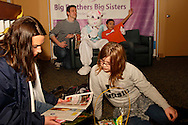 Emily Lizak of Fairborn (left) and her little sister Brooklyn, 10 of Dayton look at what Brooklyn got in an Easter basket as BBBS program development director Joe Strychalski and his little brother Derrryko, 13 get a picture with the Easter Bunny at the Big Brothers Big Sisters of the Greater Miami Valley office in Moraine, Saturday, March 23, 2013.  The baskets are prepared by Janet Fernandes of Dayton, who bought and stocked 200 Easter baskets this year.  Some are picked up and some are distributed in schools before the Spring  break.  She says she started making baskets for others a few years ago with 'leftovers,' but now she and friends start shopping for baskets and other supplies the day after Easter each year, and prepare between two and three hundred each year.