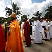 Presiding Bishop Katharine Jefferts Schori of the American Episcopal Church and the first woman elected primate in the Anglican Communion, stands with fellow primates before they process into Anglican cathedral to celebrate the Eucharist. Leaders of the world's 77 million Anglicans, in Tanzania for a closed, six-day conference, traveled by boat from the mainland to celebrate the Eucharist in the only Anglican cathedral on this predominantly Muslim archipelago on the Indian Ocean.....