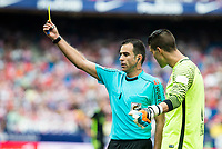 Referee talking with Atletico de Madrid's player Iván Cuéllar and Sporting de Gijon's XXX during a match of La Liga Santander at Vicente Calderon Stadium in Madrid. September 17, Spain. 2016. (ALTERPHOTOS/BorjaB.Hojas)
