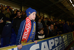 AFC Wimbledon fan with half and half scarf - Photo mandatory by-line: Dougie Allward/JMP - Mobile: 07966 386802 - 05/01/2015 - SPORT - football - London - Cherry Red Records Stadium - AFC Wimbledon v Liverpool - FA Cup - Third Round