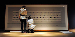 ©London News pictures. 08.02.2011. Two women inspect a piece of art by Andreas Gursky  entitled 'Untitled V, 1997'. It is excepted to fetch 800.000 - 1200.000 pounds at auction. A preview, today (Fri) of Christie's Auction House Post-War and Contemporary Art Evening Auction. The sale is expected to make a combined total of £46,246,000 to £66,447,000 when it is sold on 16th Feb 2011.. Picture Credit should read Stephen Simpson/LNP
