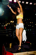 Woman dancing on the Podium. Friday 14th of Nov 2008- The first dance festival in the Middle East. Coma festival, Al Maya Island, Abu Dhabi, UAE. Middle East