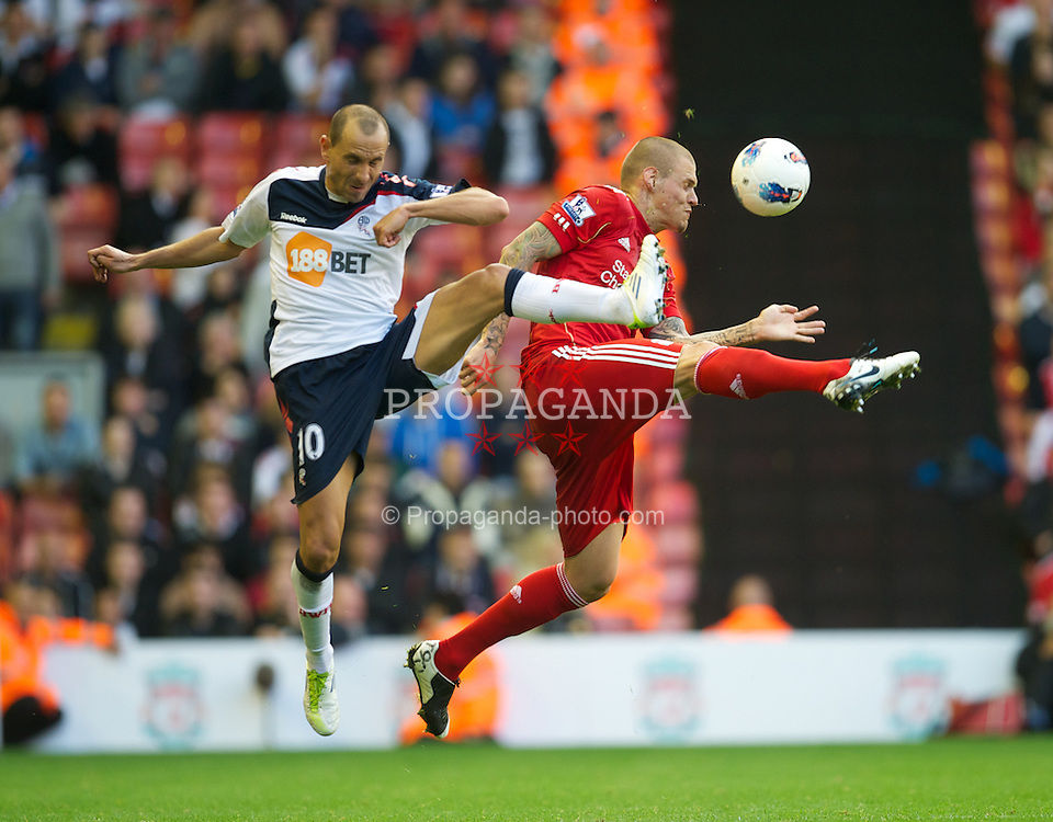 LIVERPOOL, ENGLAND - Saturday, August 27, 2011: Liverpool's Martin Skrtel in action against Bolton Wanderers' Martin Petrov during the Premiership match at Anfield. (Pic by David Rawcliffe/Propaganda)