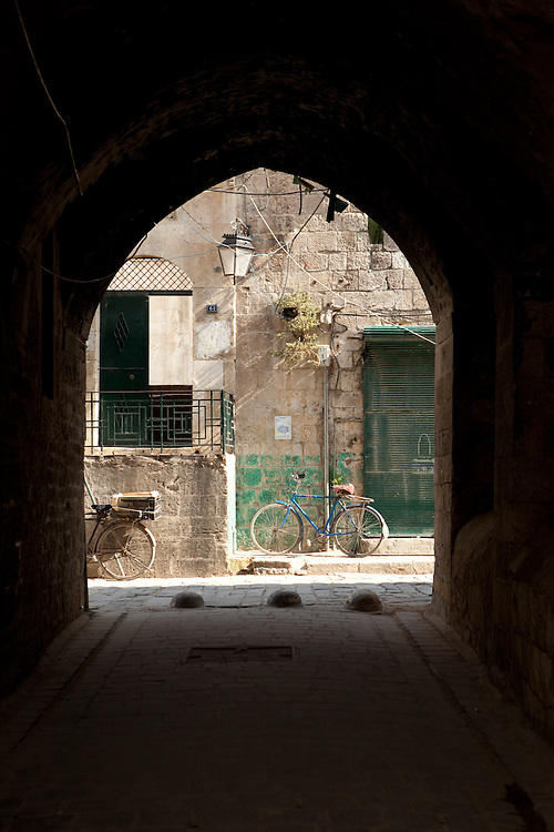 Bicycles at the end of an archway in the Old City of Aleppo, Syria