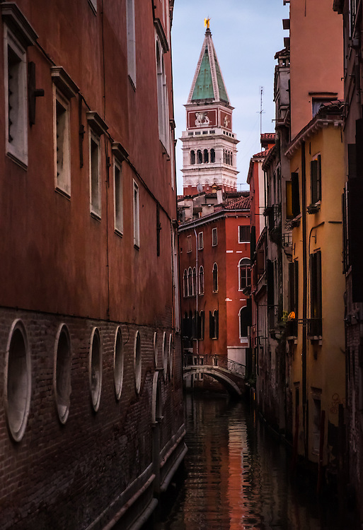 VENICE, ITALY - CIRCA MAY 2015: Typical canal and bridge in Venice with view of the  tower of Piazza San Marco