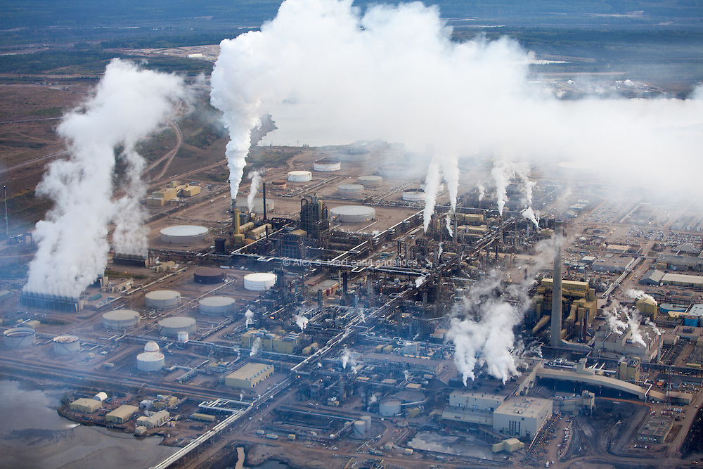 Steam and smoke rise from upgrading facility at Syncrude Mildred Lake near Fort McMurray