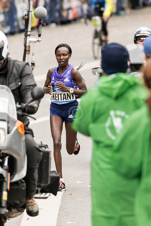 Mary Keitany, Kenya, all alone in Central Park  near mile 24