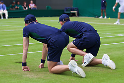 LONDON, ENGLAND - Tuesday, June 28, 2016: Two ball boys during the Gentlemen's Singles 1st Round match on day two of the Wimbledon Lawn Tennis Championships at the All England Lawn Tennis and Croquet Club. (Pic by Kirsten Holst/Propaganda)